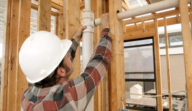 Residential Construction Worker Fitting Pipe-1